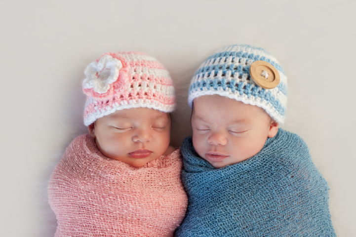 Newborn girl and boy
